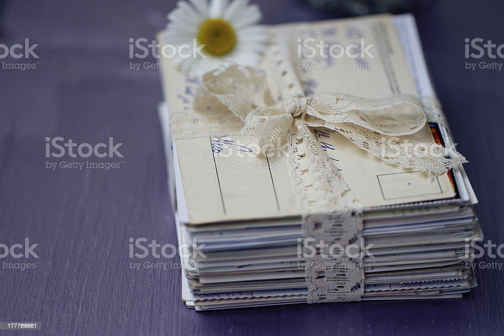 stack of old letters with chamomile royalty-free stock photo