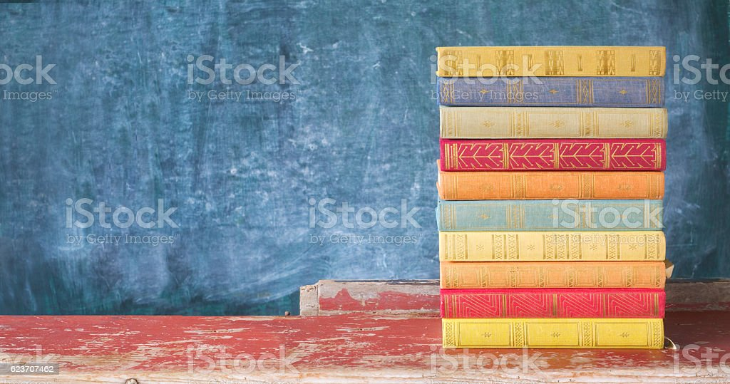 stack of old multicolored books stock photo