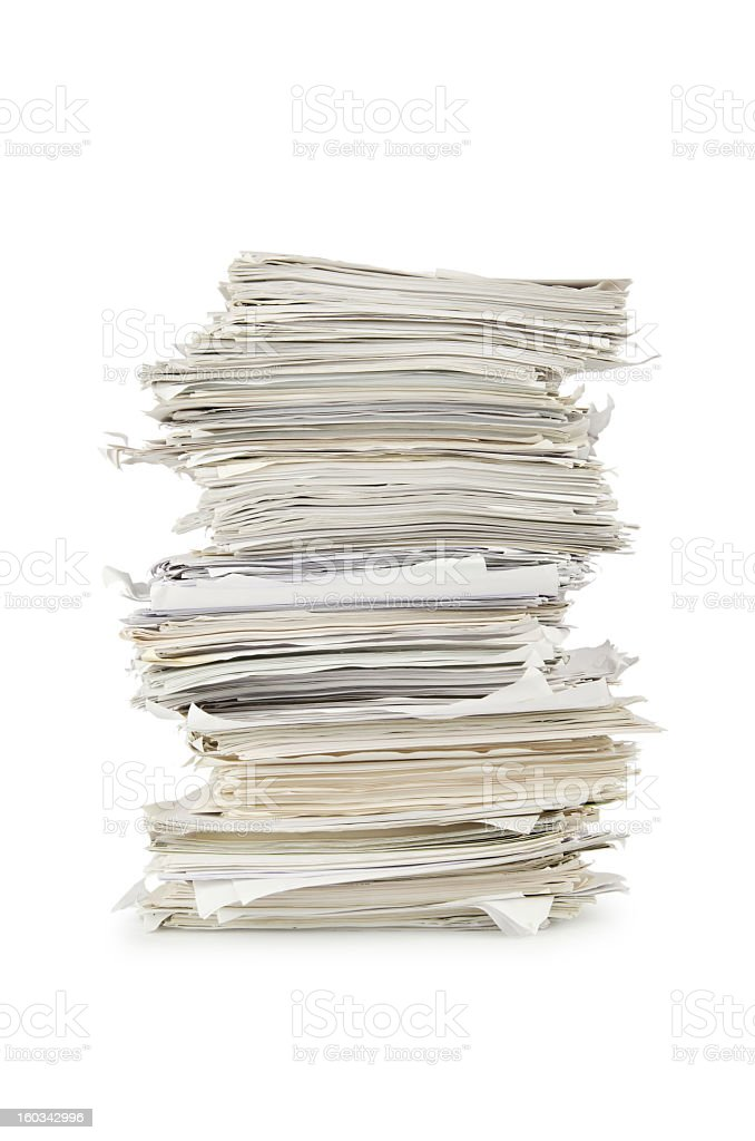 Stack of old newspapers with a white background stock photo