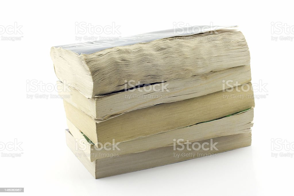 Stack of old paperbacks, isolated royalty-free stock photo