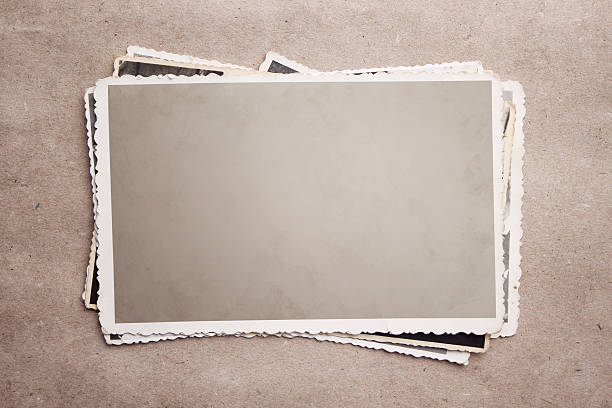 a stack of old photograph clippings - nostalji stok fotoğraflar ve resimler