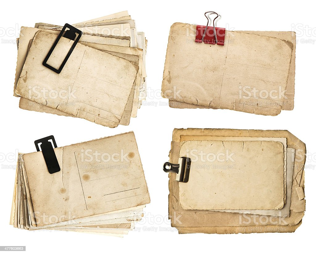 stack of old postcards isolated on white background stock photo