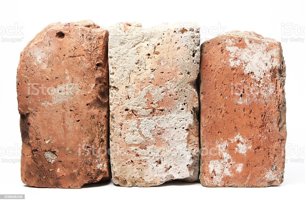 Stack of old red bricks stock photo