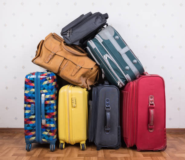 A stack of old suitcases stock photo