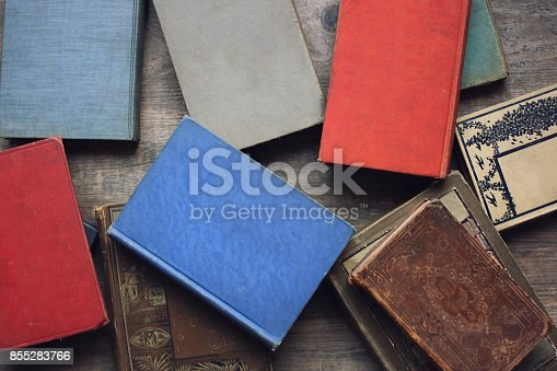 istock Stack of Old Vintage Books From Above on Rustic Wood Table 855283766