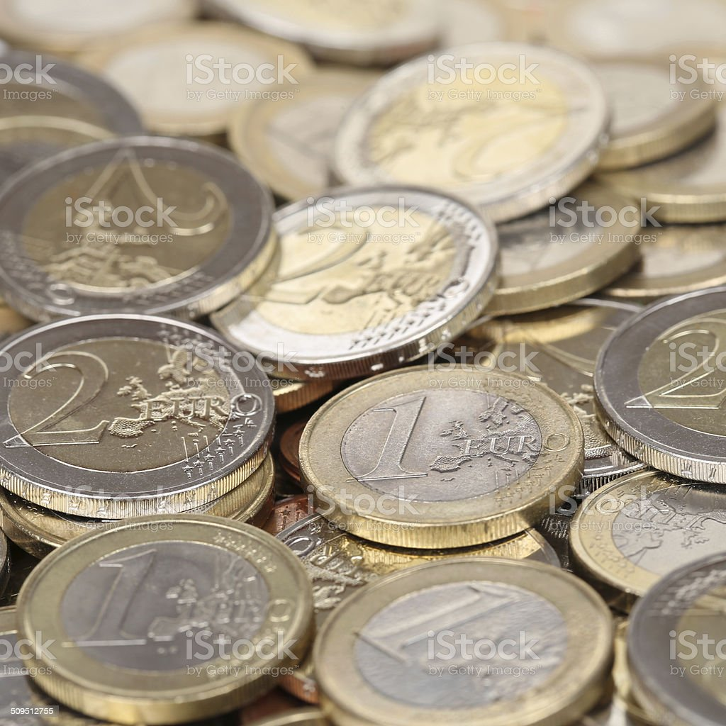 Stack of one and two Euro coins stock photo