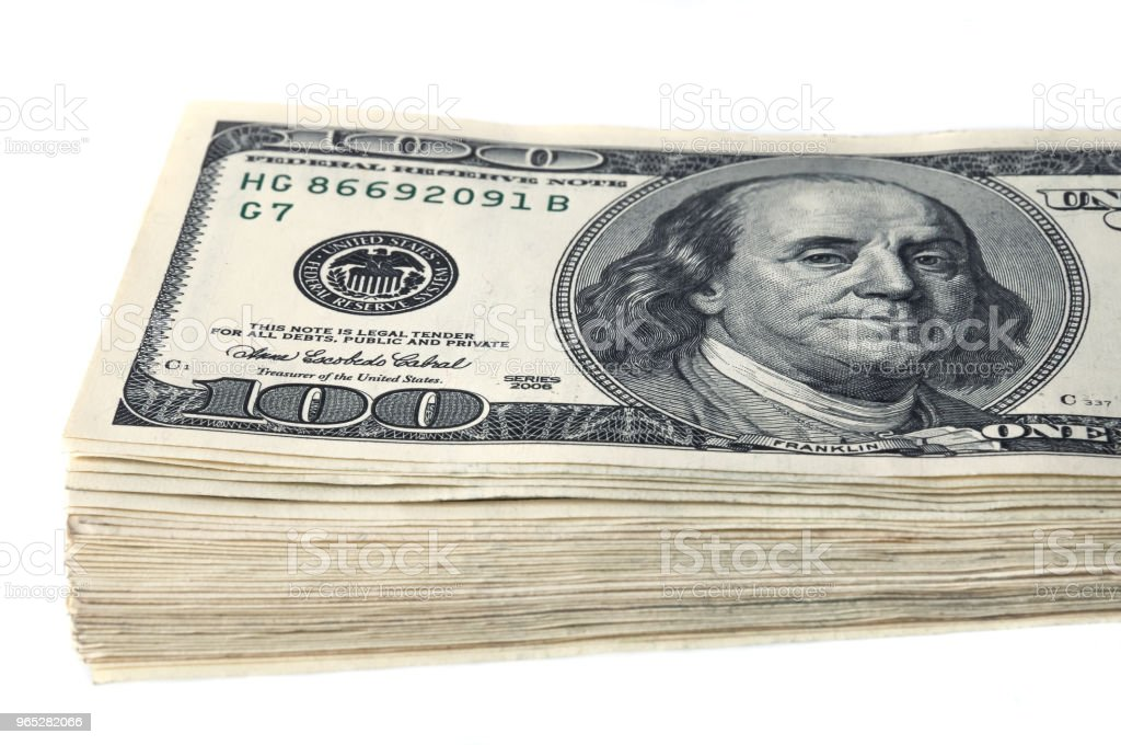 A stack of one hundred dollar bills on a white background. Isolated. royalty-free stock photo