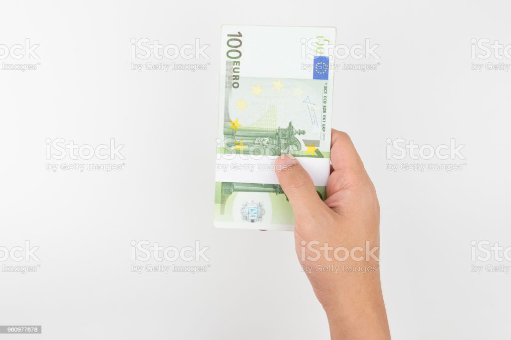 Stack of one hundred euro bills isolated on white background for financial. stock photo