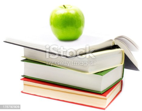 502086873 istock photo Stack of open books  with green apple on white background. 175792926