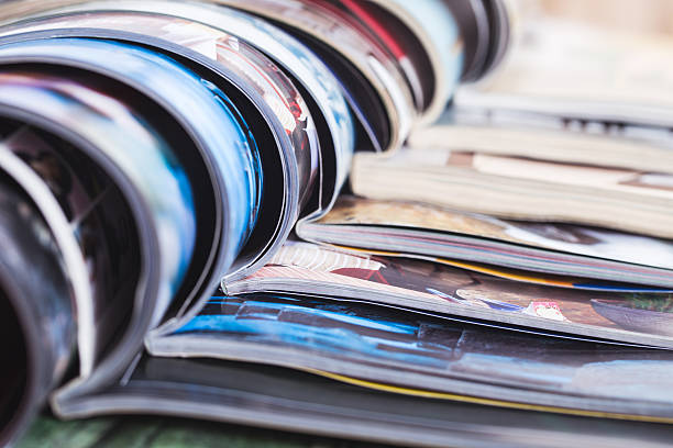 stack of open colorful magazines. information - catalogue stock photos and pictures