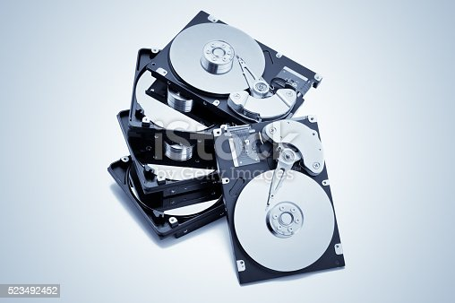 Stack of open harddrives. Isolated on the white background