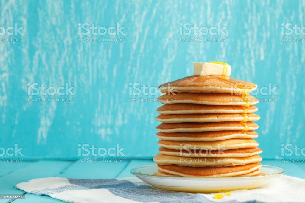 Stack of pancake with honey and butter on top stock photo