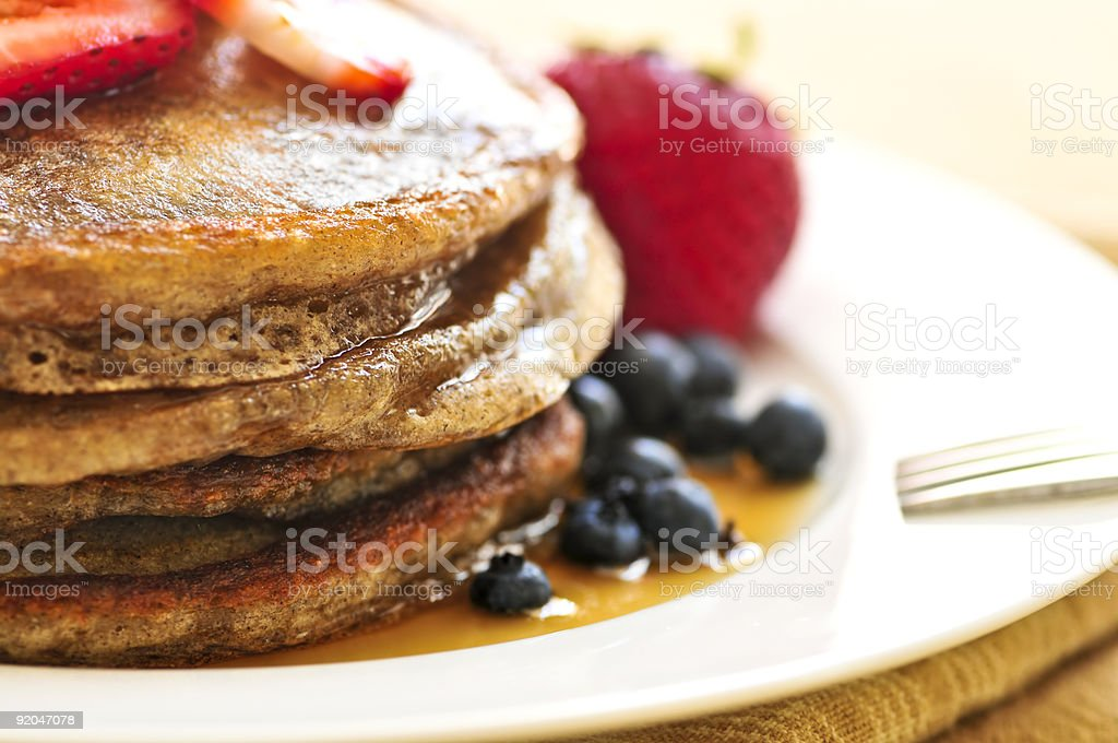 A stack of pancakes and fruit for breakfast stock photo