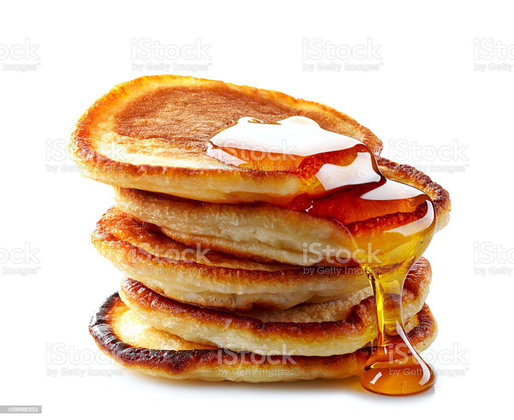 Stack of pancakes dripping with maple syrup stock photo