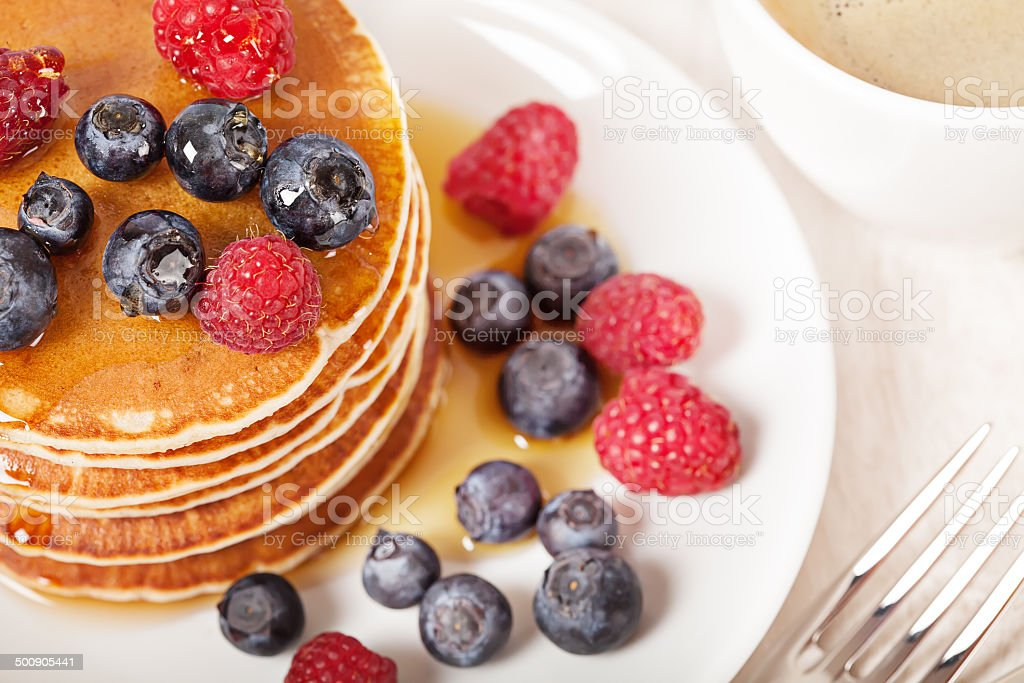 Stack of pancakes with berries breakfast stock photo