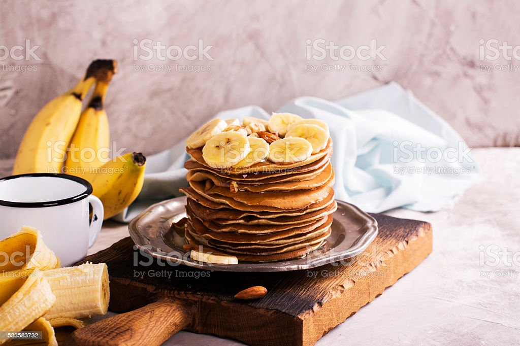 Stack of pancakes with ingredients stock photo