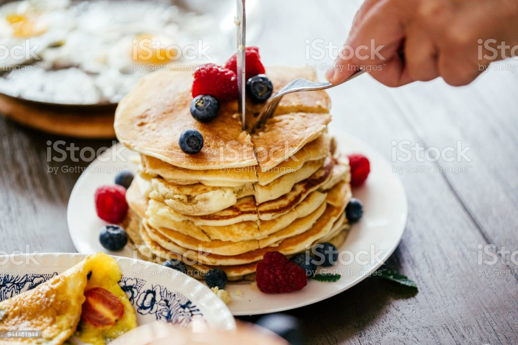 Stack of Pancakes with Maple Syrup and Fresh Berries stock photo