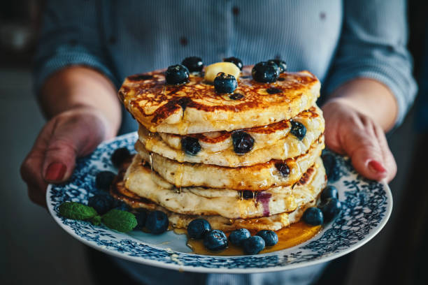 Stack of Pancakes with Maple Syrup and Fresh Blueberries stock photo