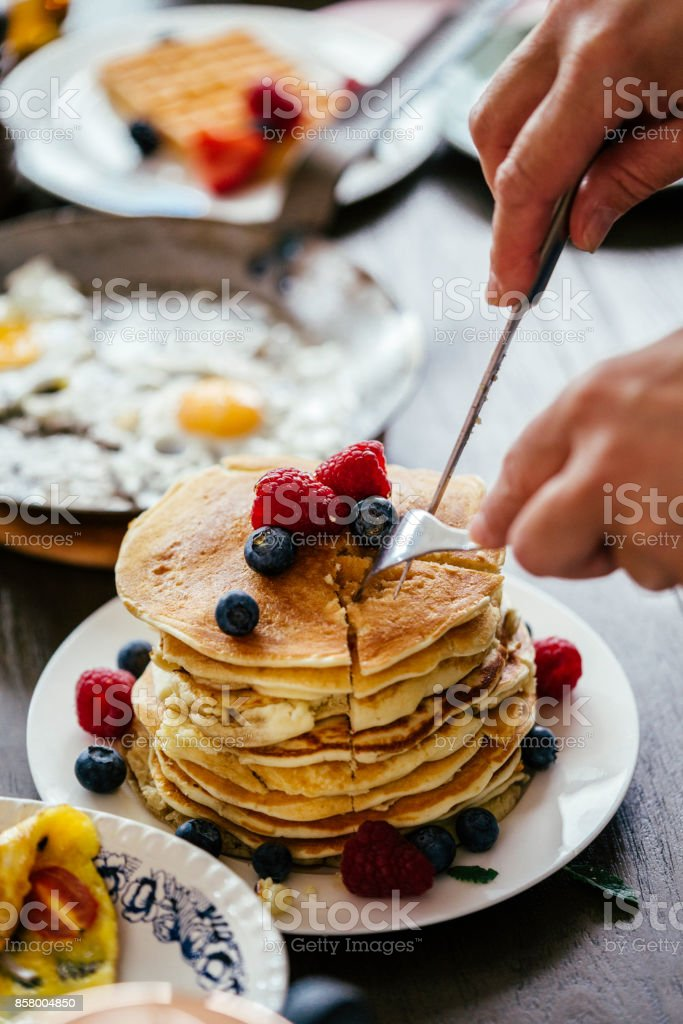 Stack of Pancakes with Maple Syrup, Berries and Fresh Coffee stock photo