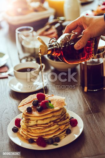 Stack of Pancakes with Maple Syrup, Berries and Fresh Coffee for breakfast