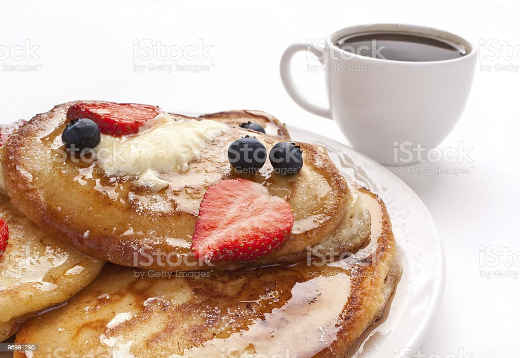 stack of pancakes with syrup and fruit royalty-free stock photo