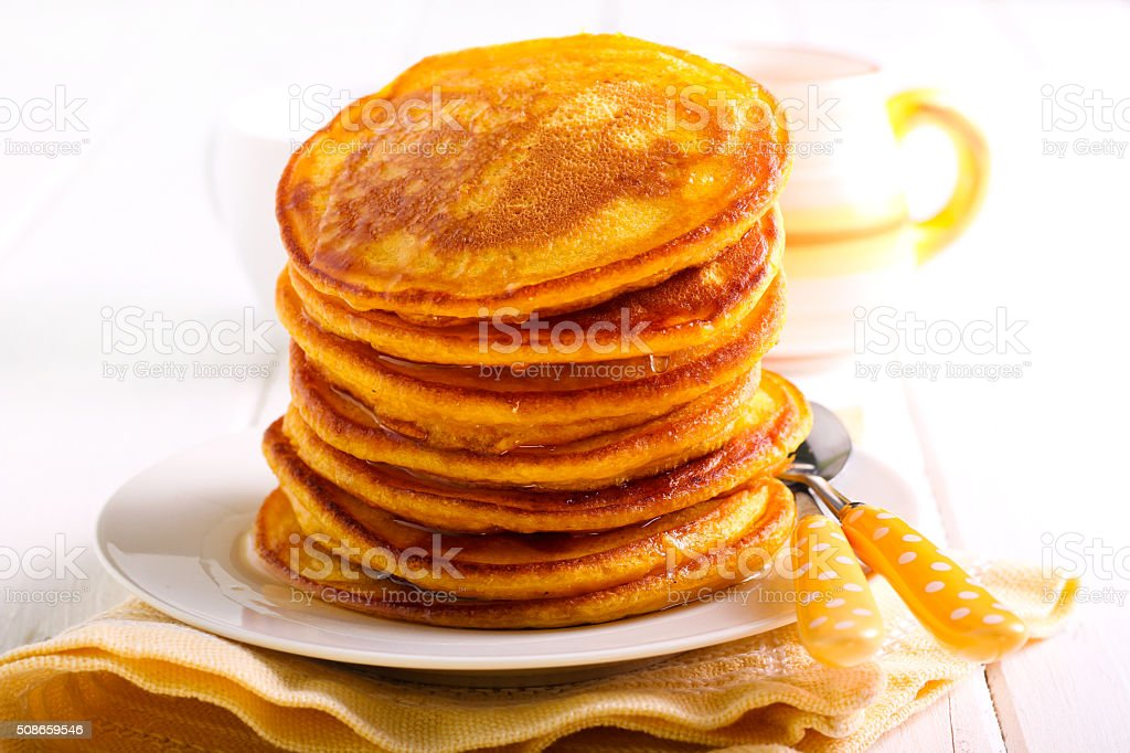 Stack of pancakes with syrup stock photo