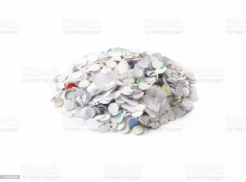 Stack of paper opened with hole puncher on white background stock photo