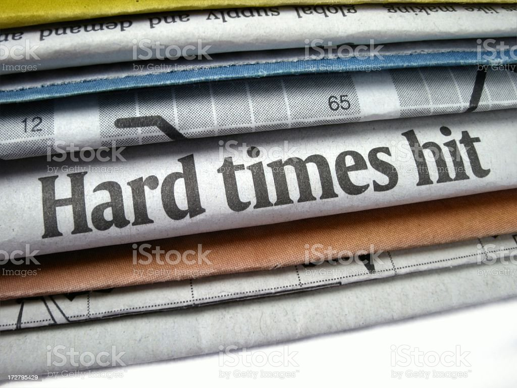 Stack of papers with the headline hard times hit showing royalty-free stock photo