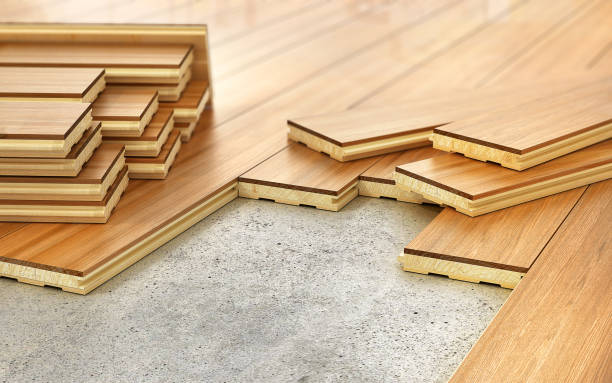 Stack of parquet. Timberwork, lumber work and woodwork industry concept: stacks of wooden timber planks on the wooden floor. 3d illustration stock photo