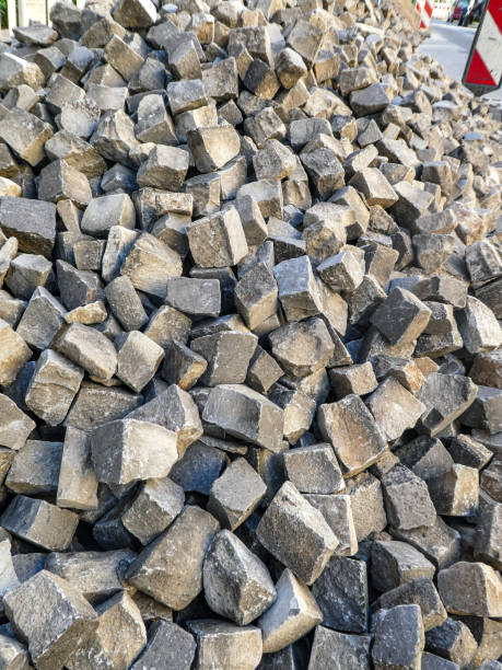 Stack of paving cobblestone cubes on construction site stock photo