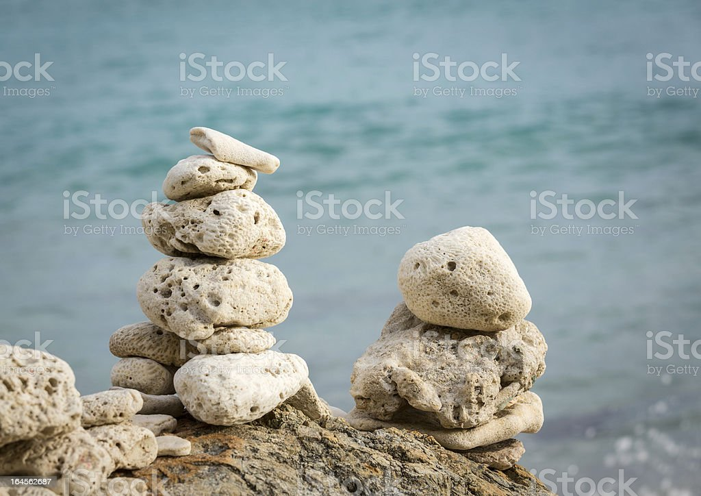Stack of pebbles by ocean seaside royalty-free stock photo