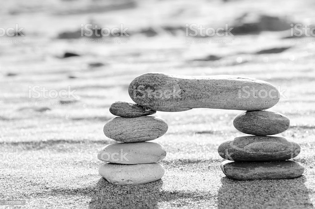 Stack of pebbles in black and white, zen concept stock photo