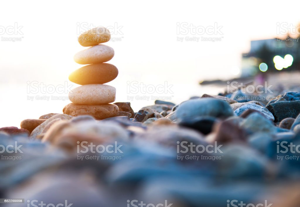 Stack of pebbles on beach stock photo