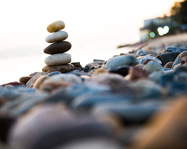 stack of pebbles - stack rock stock pictures, royalty-free photos & images