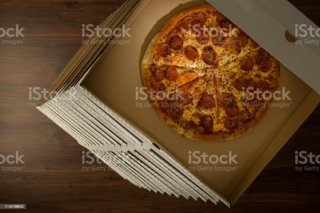 Stack of pizzas stock photo