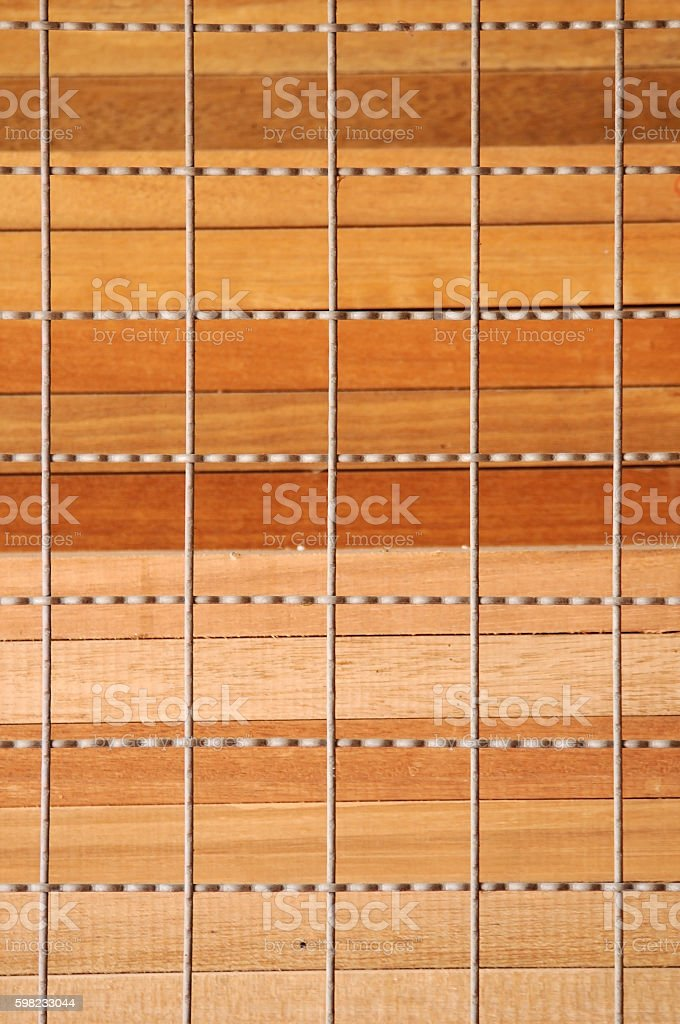 Stack of plank wood with wall wire foto royalty-free