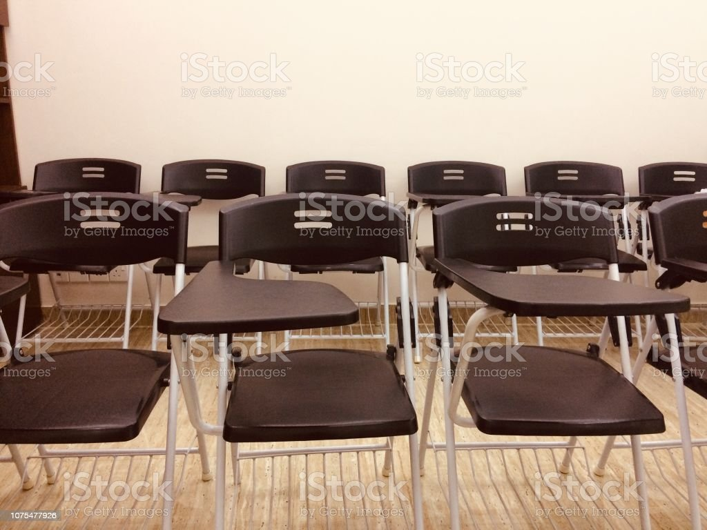 Stack Of Plastic Chairs In A Conference Room Stock Photo - Download Image  Now