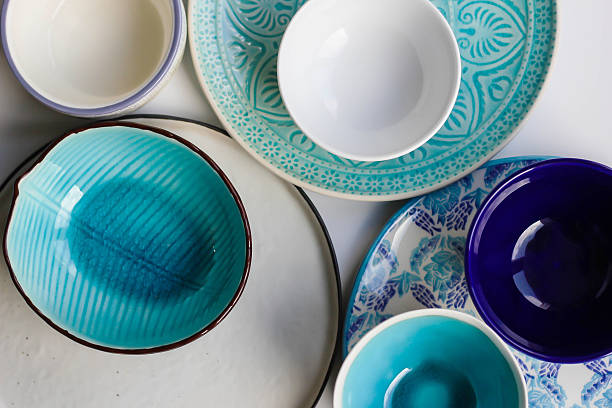 stack of plates and bowls - crockery stock photos and pictures