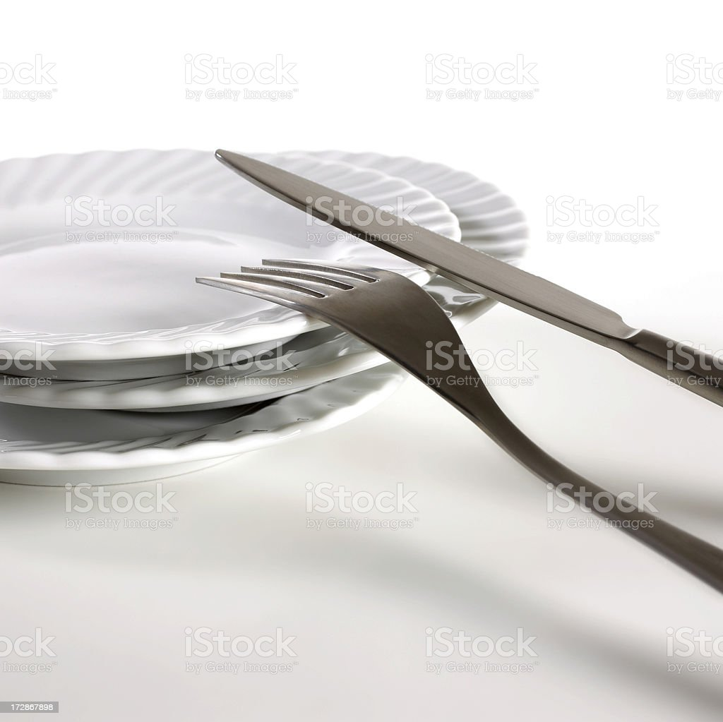 Stack of plates and cutlery royalty-free stock photo