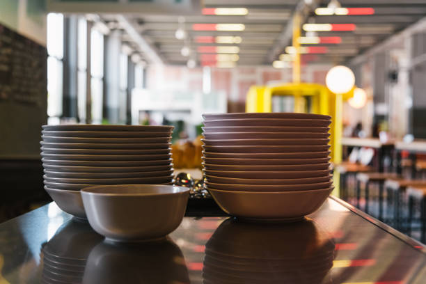 stack of plates in restaurant - commercial dishwasher stock photos and pictures