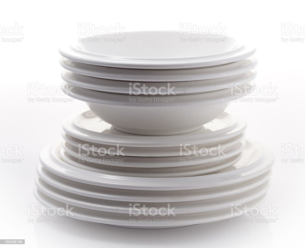 Stack of plates isolated on plain background stock photo