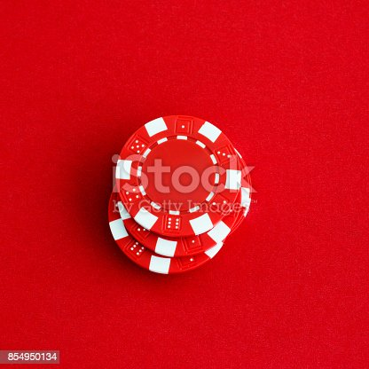 A stack of poker chips on red background
