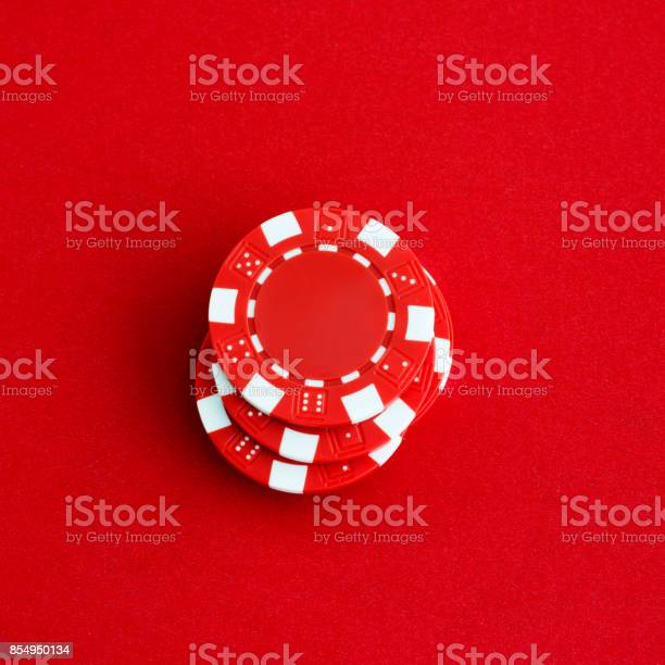 Stack of poker chips on red background picture id854950134?b=1&k=6&m=854950134&s=612x612&h=vfufixwzopyhacq myfqdpaxygzrectfpcgxunvdwjo=