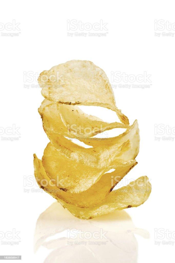 Stack of potato crisps on a white background royalty-free stock photo