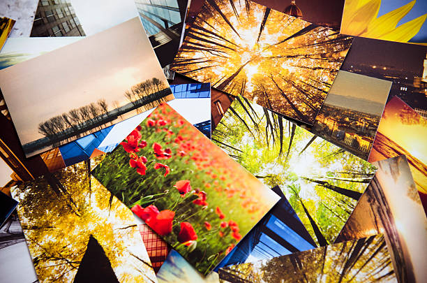 Stack of printed colorful images stock photo