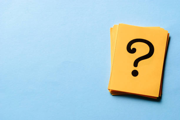 Stack of question marks on yellow cards stock photo