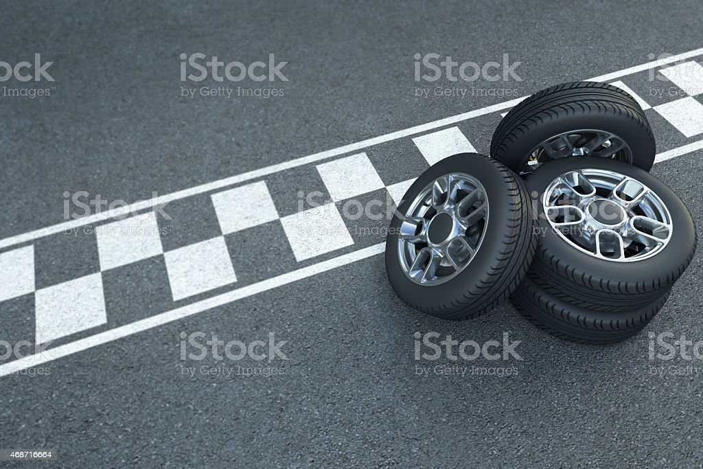 A stack of racing wheels on an asphalt background stock photo