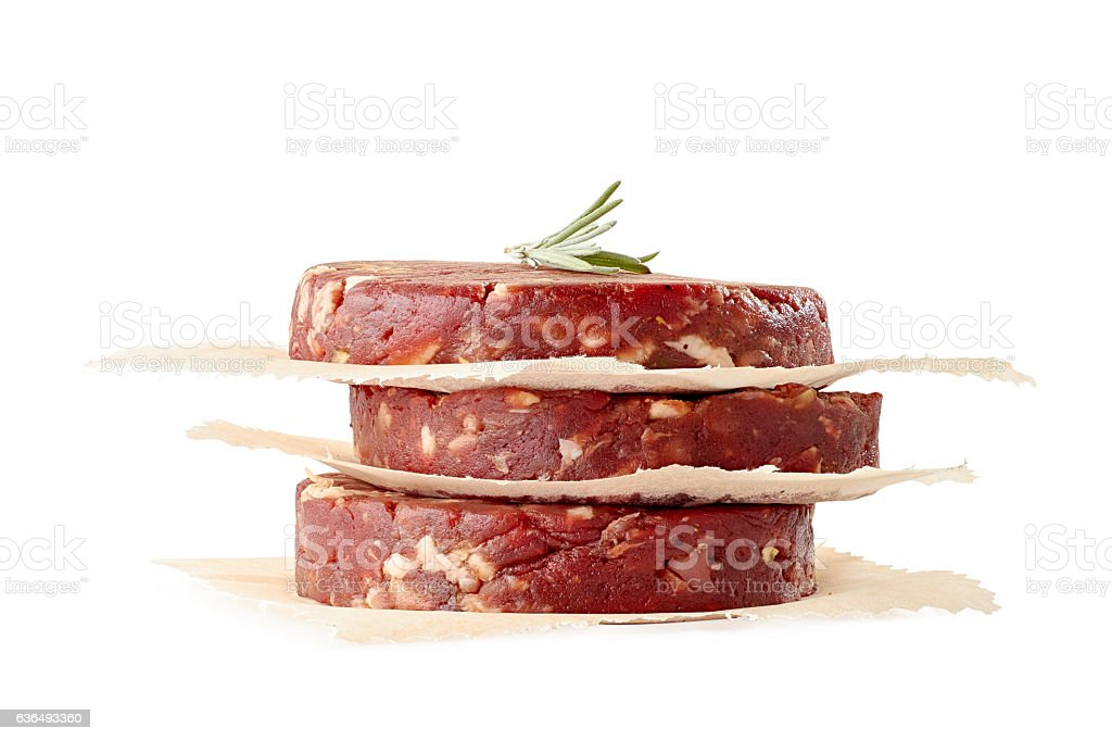 Stack of raw beef burger patties on white stock photo