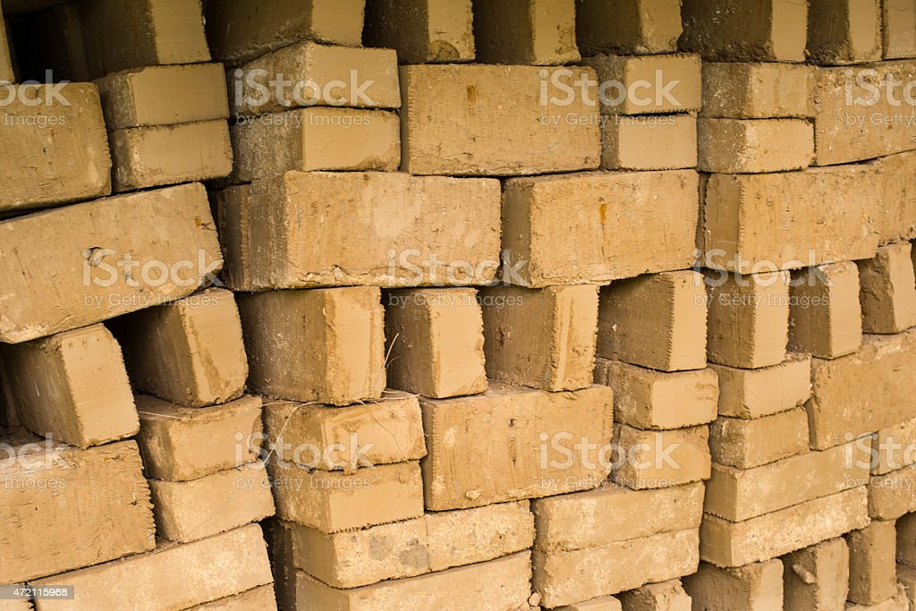 Stack of raw bricks drying in the open air stock photo