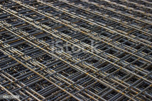 Stack of rebar grids at the construction site. Selective focus.